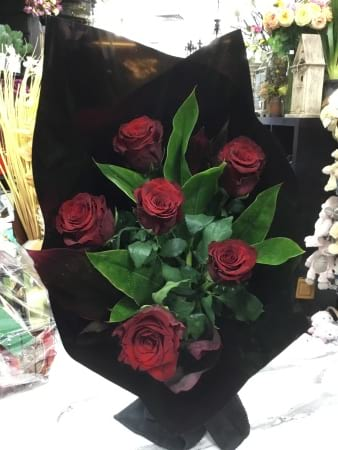 six rose long stem bouquet with lush foilage