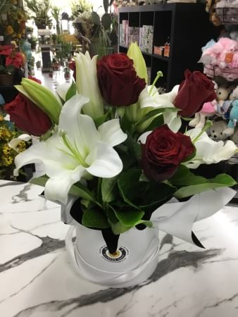 Red rose and white oriental lily hat box arrangement