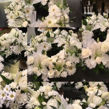 Florist choice white funeral wreath