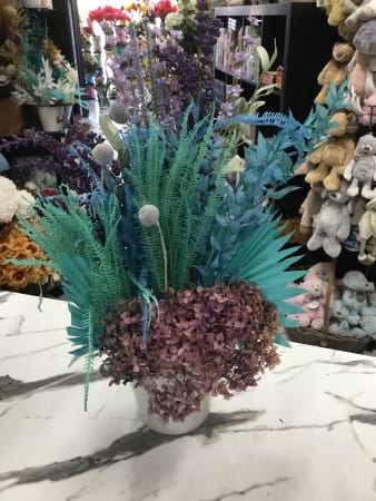peacock preserved and artificial floral arrangement